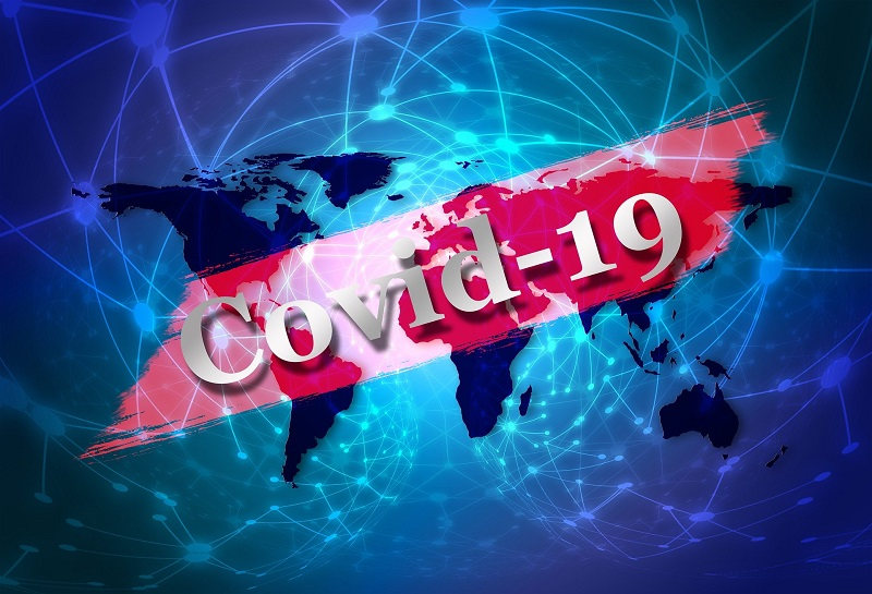 COVID-19 typed on a red banner in front of a flattened globe - Radon-Rid