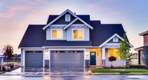 Suburban home at twilight | frequently asked questions about radon testing | Keystone ETS