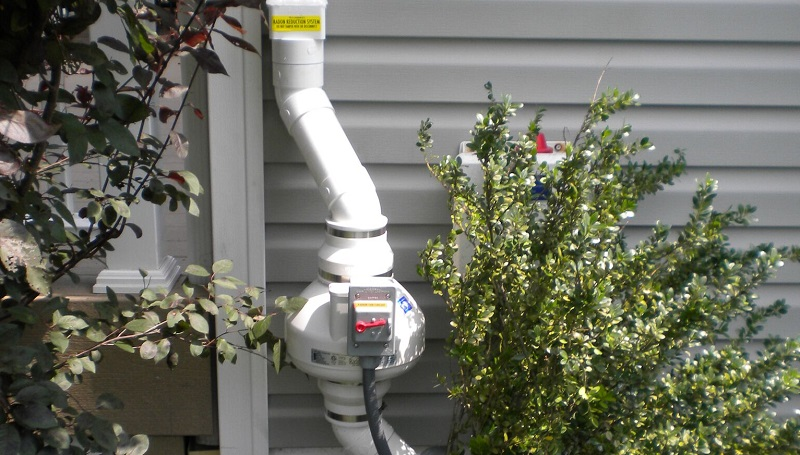 Photo of radon gas mitigation system | FAQS about Radon Remediation | Radon-Rid, LLC.