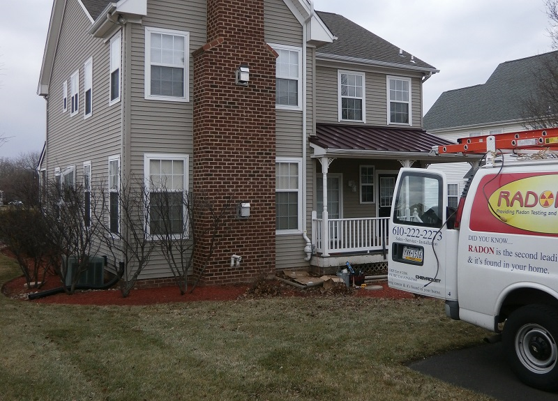 Photo of radon testing van parked in front of house | FAQS about Radon Remediation | Radon-Rid, LLC.